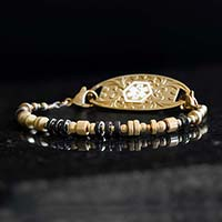Medical ID bracelet strand with gold and black beaded accents