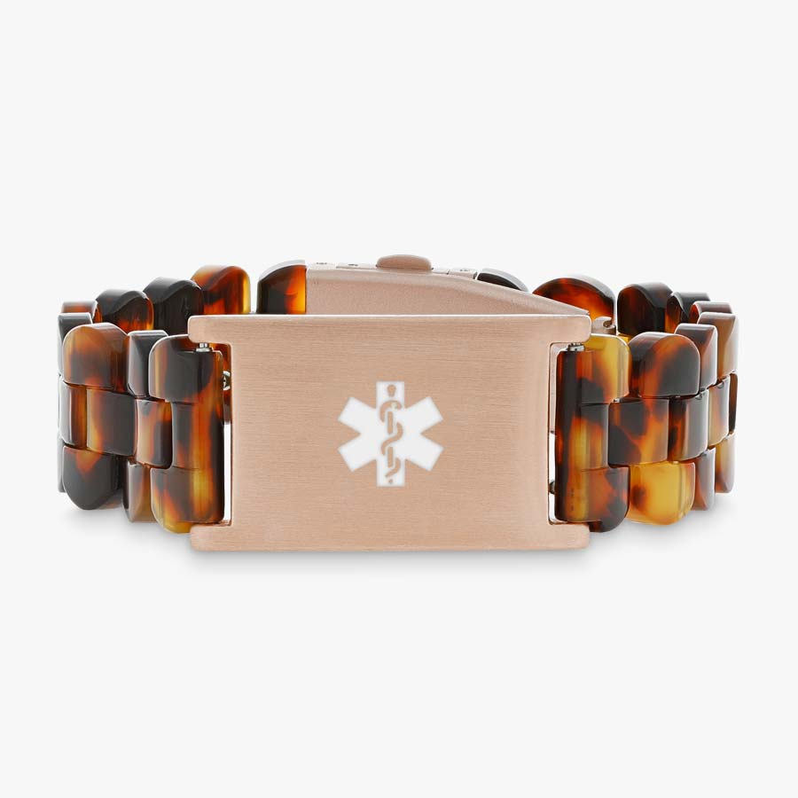 Tortoiseshell and rose gold medical ID bracelet with resin band.