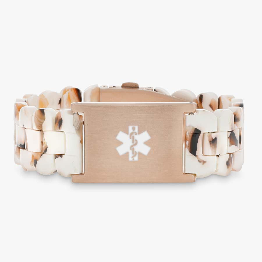 Cream and rose gold medical ID bracelet with resin band.