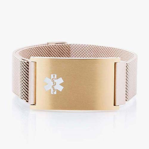 Front of magnetic stainless steel mesh band bracelet with magnetic closure and affixed med ID tag in brushed sandstone with white caduceus.