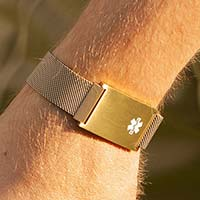 Man golfing and wearing stainless steel medical ID bracelet with magnetic clasp