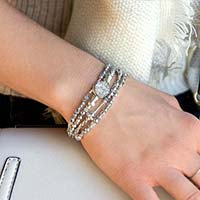 Woman wearing multi-strand beaded medical ID bracelet with sterling and crystal beads