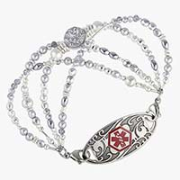 Multi strand bracelet made of Silver-leafed silver druzy quartz centerpiece and faceted, hammered, and matte sterling silver elements