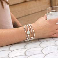 Woman wearing sparkly silver beaded medical ID bracelet with silver druzy centerpiece