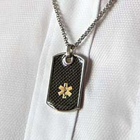 Man wearing black textured dog tag medical ID necklace.