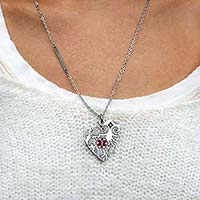 Heart shaped stainless steel alert necklace with red medical symbol attached to a stainless steel ball chain.