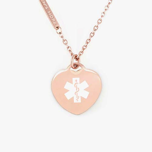 Rose gold tone heart shaped medical alert pendant with white medical symbol on matching necklace chain