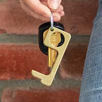 Woman holding CleanTouch Keychain attached to car keys