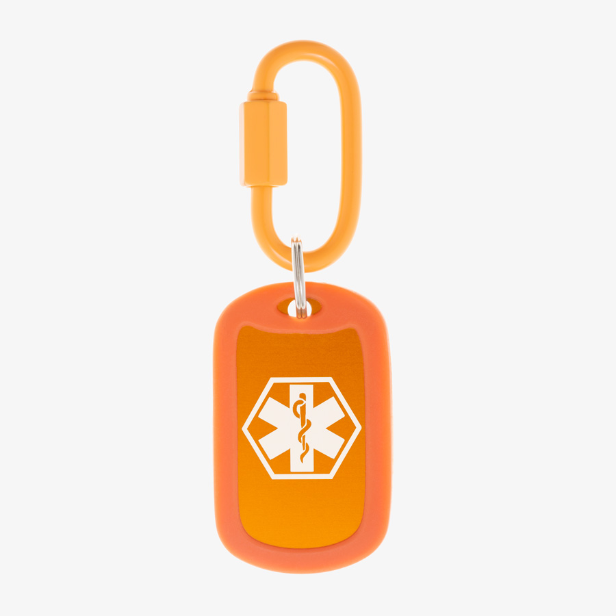 Carrot aluminum bag tag with white medical symbol and coordinating silicone silencer on matching carabiner clip.